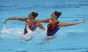 Greece's Evangelia Platanioti and Despoina Solomou perform in the synchronised swimming duet technical routine preliminaries during the World Swimming Championships at the Sant Jordi arena in Barcelona